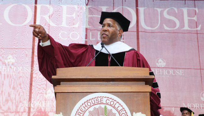 A picture Robert F Smith delivering his commencement speech during graduation ceremony at Morehouse College in 2019