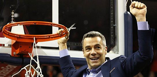 """University of Virginia Men's Basketball coach Tony Bennett celebrates after winning a national championship in 2018-2019 by cutting the net off the hoop. From John Ed Mathison's Blog """"Realize What's Real"""""""