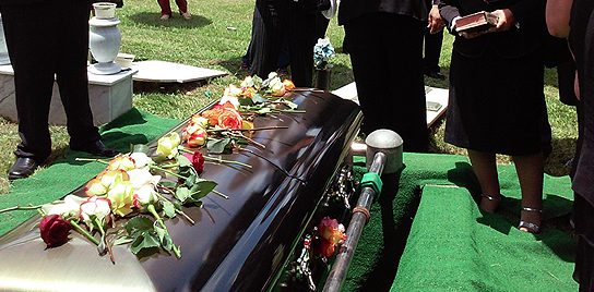 """A photo of a gravesite funeral from John Ed Mathison's blog """"Funeral Lessons"""""""