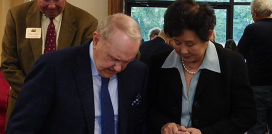 John Ed and Sieu Tang praying together.