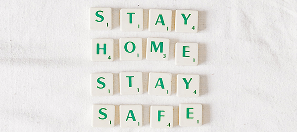 Uncertainty reigns, but we should all Stay Home, Stay Safe (four words spelled out with Scrabble tiles).