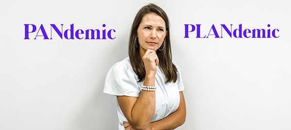 A woman considering if this is a PANdemic or a PLANdemic.