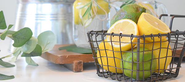 Lemons and limes in a basket.