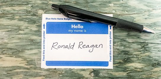 "A name tag with ""Ronald Reagan"" written on it."